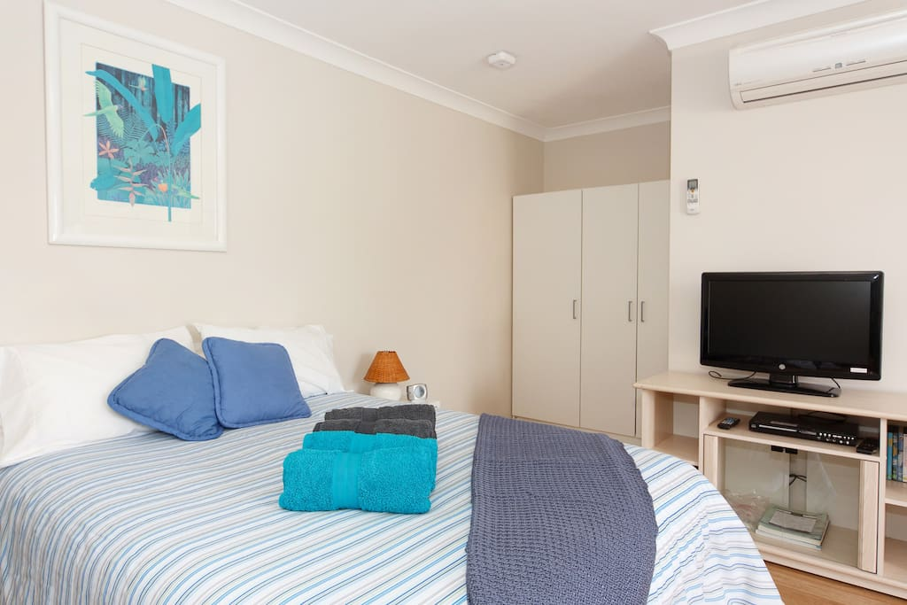 Bed, reverse cycle Air Conditioning. See below for updated photo of large screen smart TV