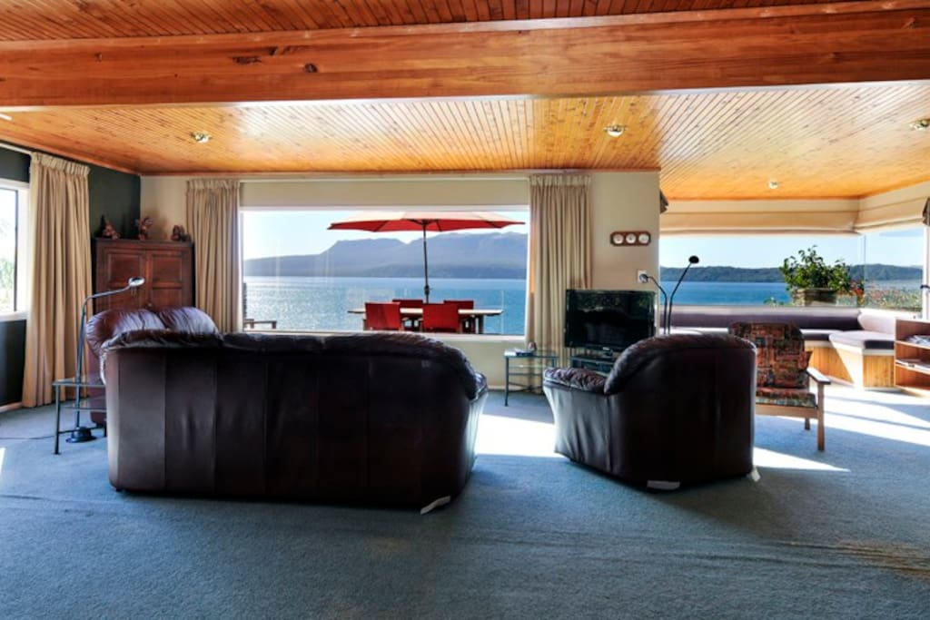 Upstairs lounge and view over deck and out to the lake