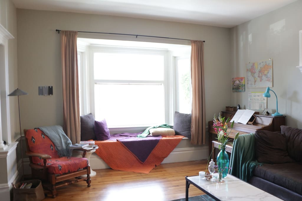 Reading nook, piano, and comfy window seat.