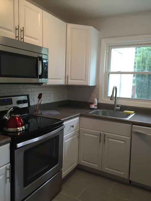 Fully renovated kitchen, stocked with coffee, tea and a french press for guests.