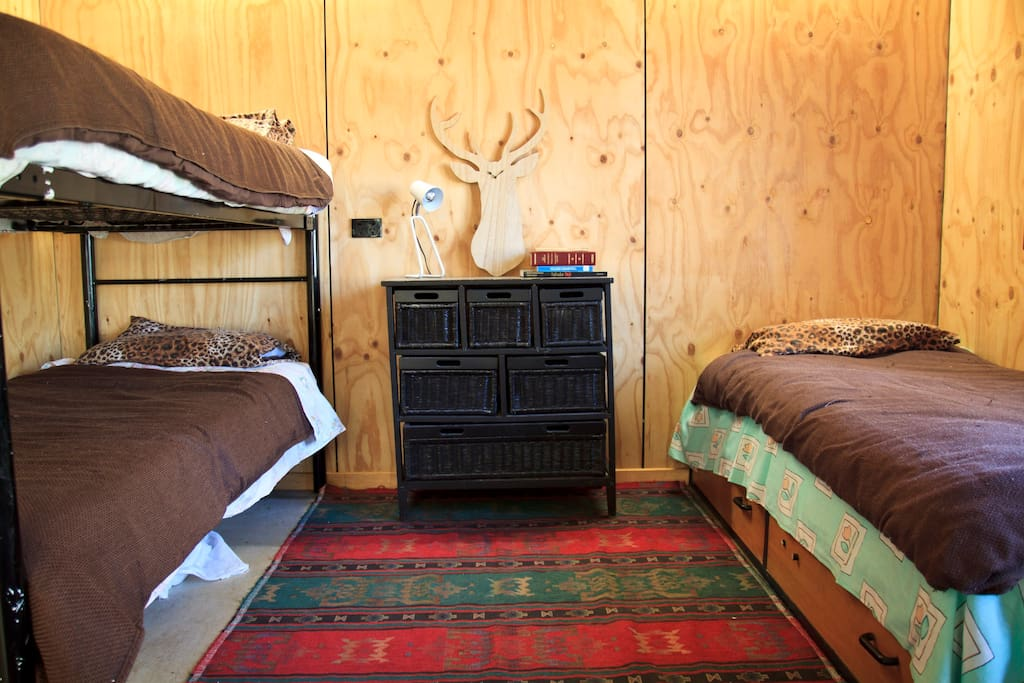 3 single beds in insulated bunk room comfort. This is often changed to be the double bed room and bunks in smaller room, this room fits a DB and  Single bed, all linen and towels supplied