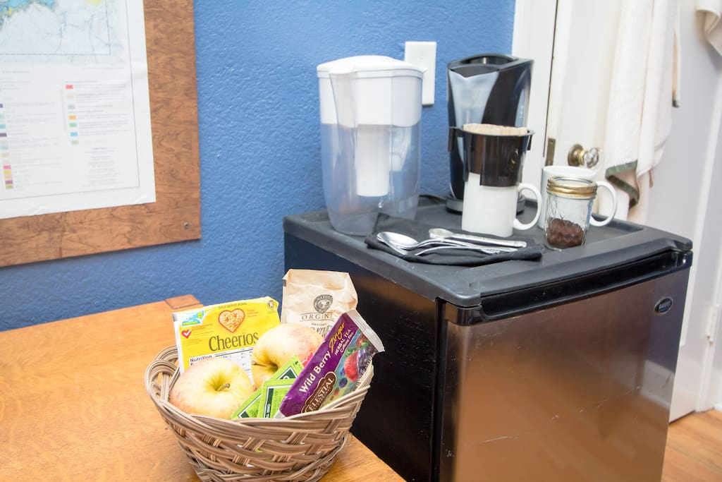 You'll find in-room coffee and tea fixings, as well as a  light breakfast that often includes fruit, oatmeal, and granola bars.  The fridge also has a beer or two and some sodas.