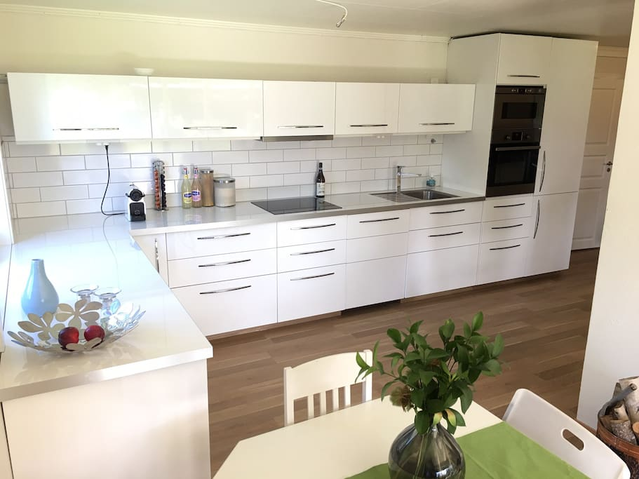 Kitchen with cooking top, stove, dish washer and micro wave.