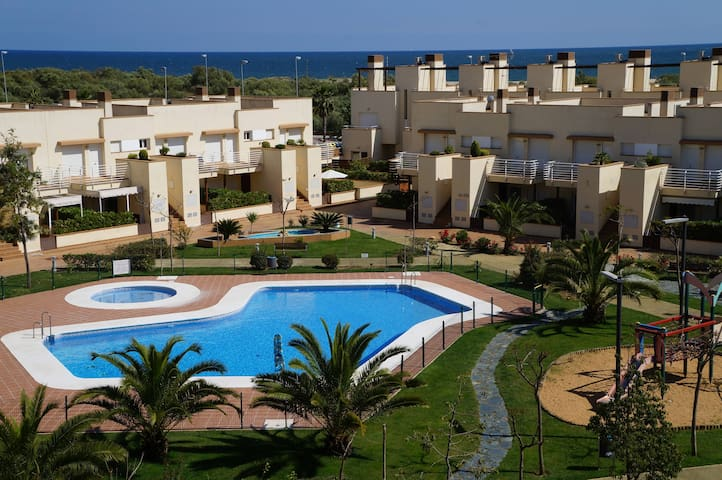 Unifamiliar 3 habts. 1ª línea playa - Isla Cristina - Huis