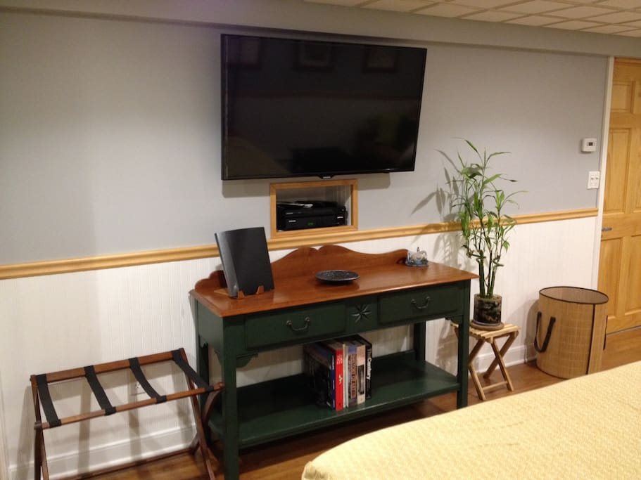 Large flat screen tv with cable and blueray player.