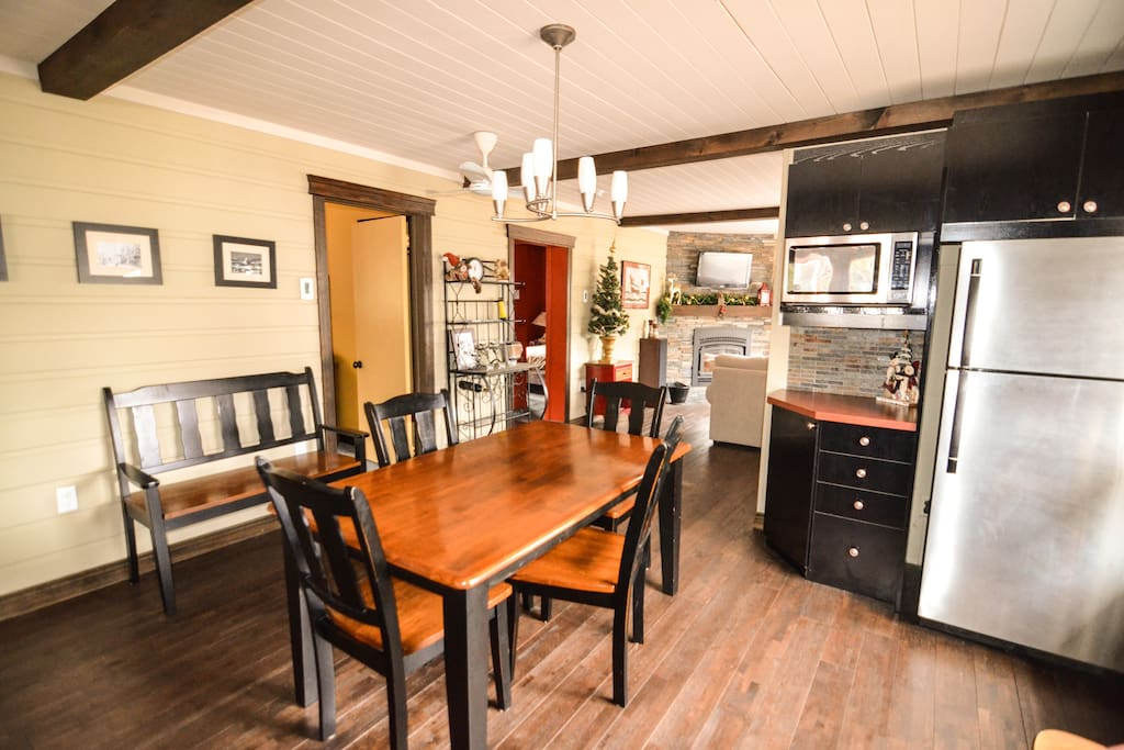 Kitchen is supplied with dishwasher, microwave, toaster, coffee maker, fridge, stove.