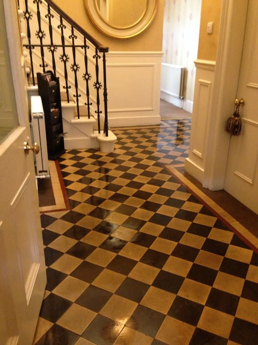 original flooring to hall and vestibule.