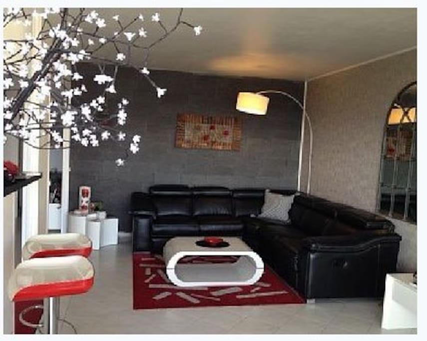 Large open living room...new leather sofa with two built in recliner ends Big Flat Screen Bose System and Eng. TV