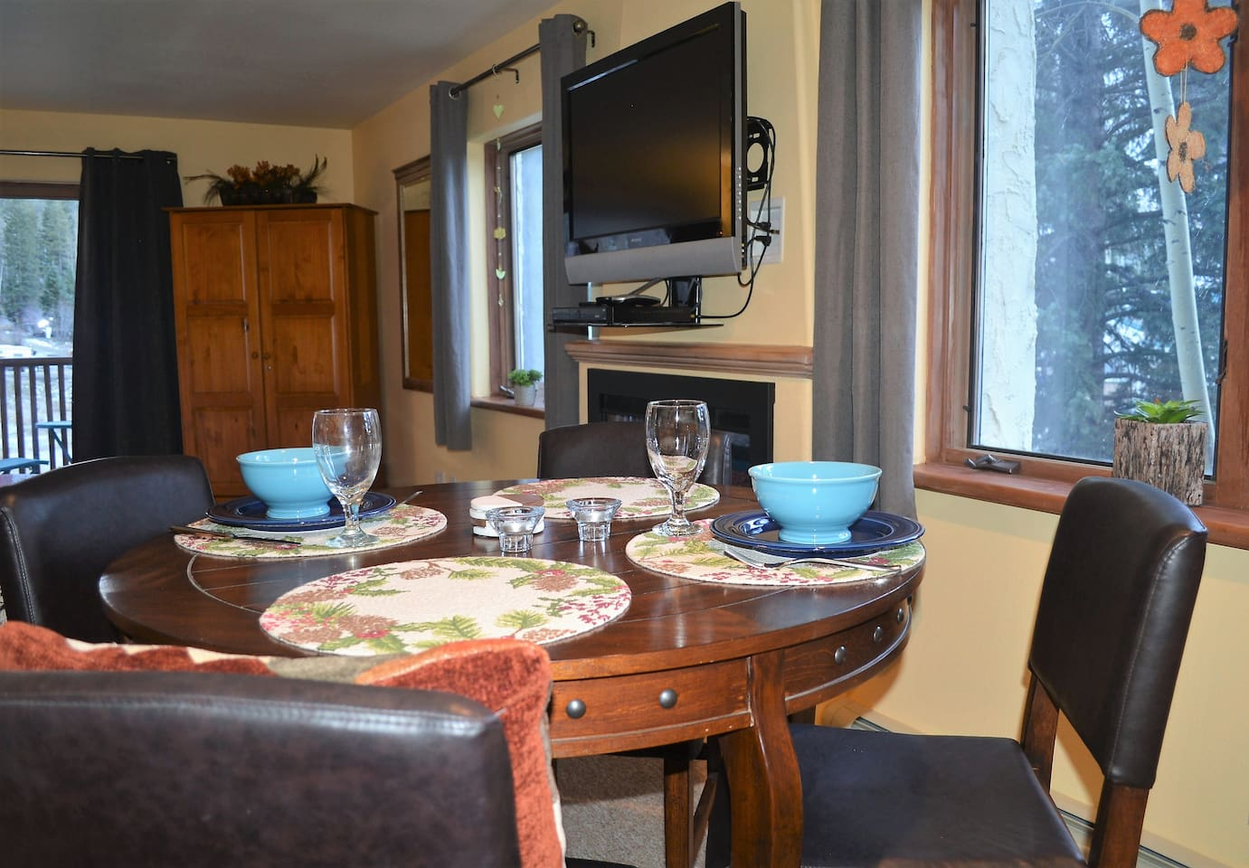 Dining Area with Fireplace and TV