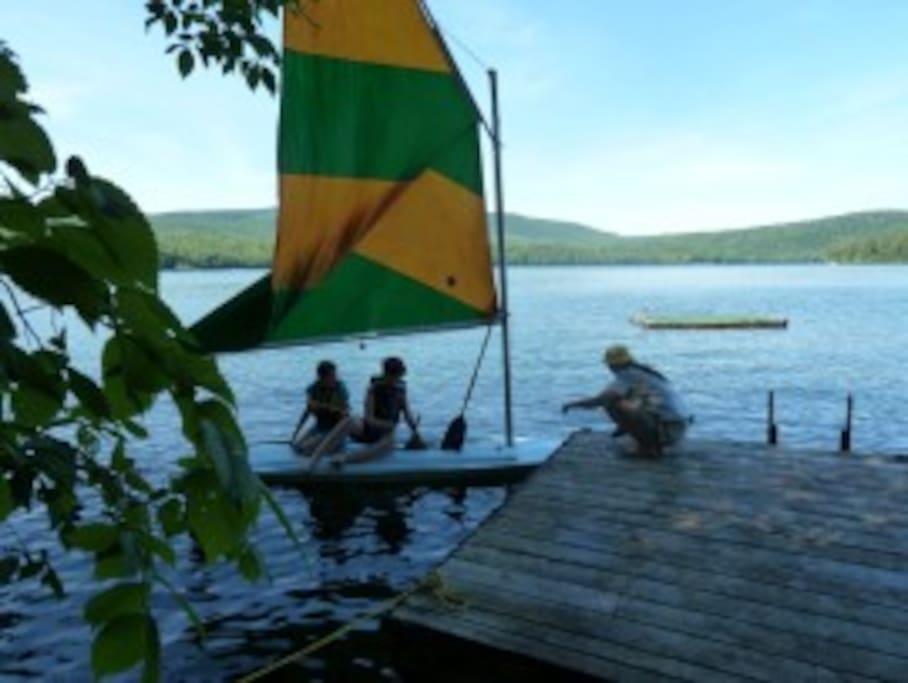 Dock, raft and sailboat