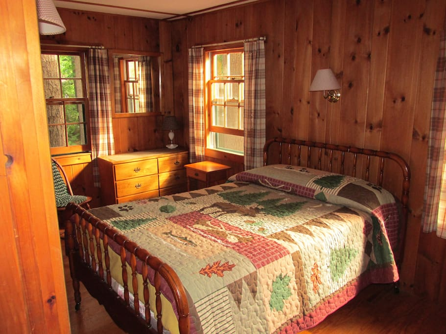 Knotty pine bedroom with a queen size bed