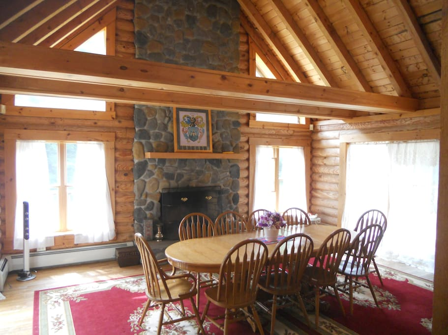 The main dining room w/ stone fire place.