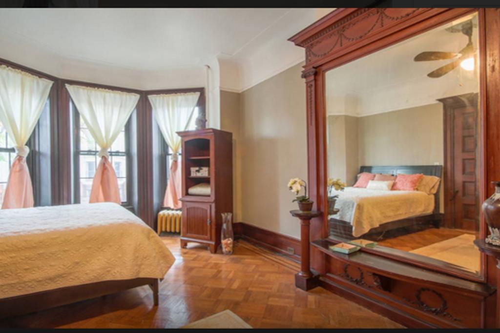 MBR ||: Floor - Ceiling Mantled Mirror; Triple Bay Windows