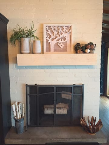 Decorative fireplace in dining room area.