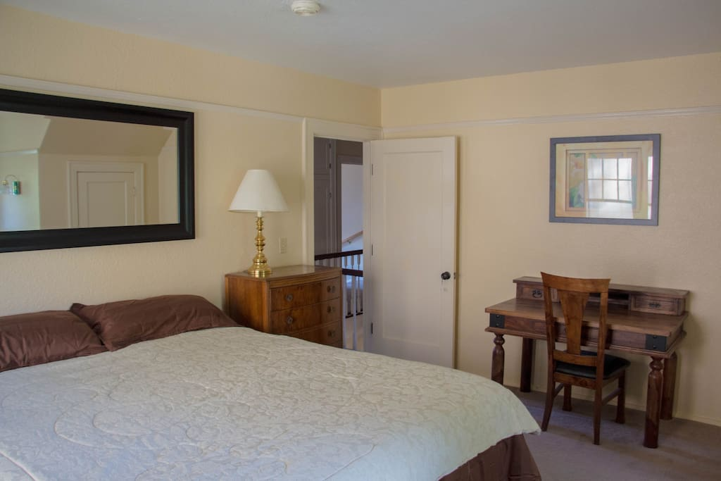 The Magnolia Room with writing desk and California King bed.