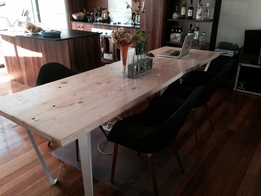 Food tastes better on a custom made dining table and Eames dining chairs.