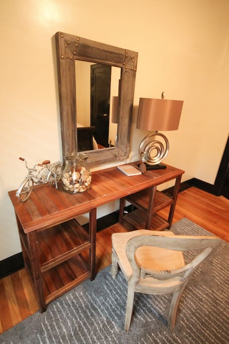 Unit 1 has a bedroom with a king-sized bed, a writing desk and a closet.