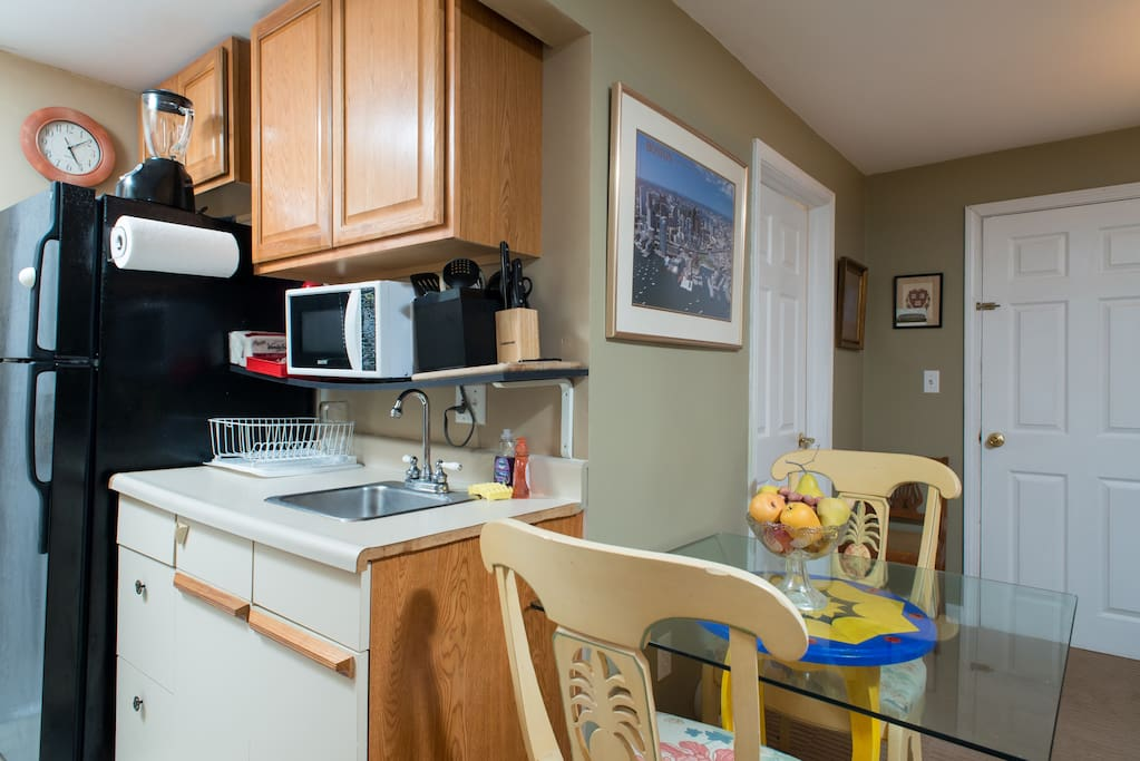 Kitchenette with small oven, two burners, coffee maker, and microwave, and expresso machine