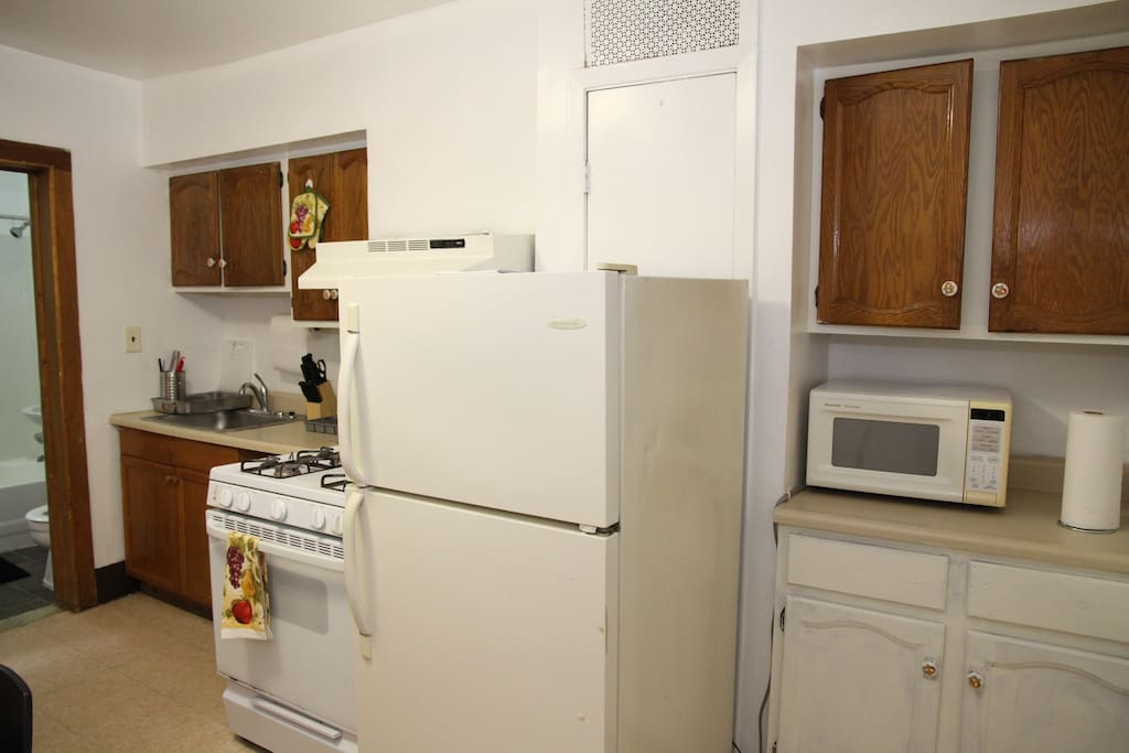 Microwave and full refrigerator