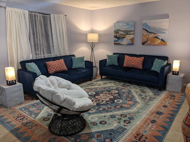 Cute living room decor including 2 FUTON couches