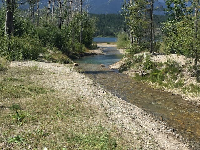 Follow Windermere Creek as it flows through the property and out to the Lake