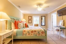 Master Bedroom Suite Serenity has a king bed, island style furniture, a flat panel TV, a large walk-in closet and a deluxe en-suite bathroom which includes a separate tub and shower.