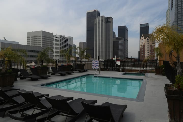 Rooftop with Pool & Jacuzzi Hot tub. Hours are 7am-Midnight. Smoking allowed! View is amazing for sunrise/sunsets! Lounge area with restroom also on rooftop.