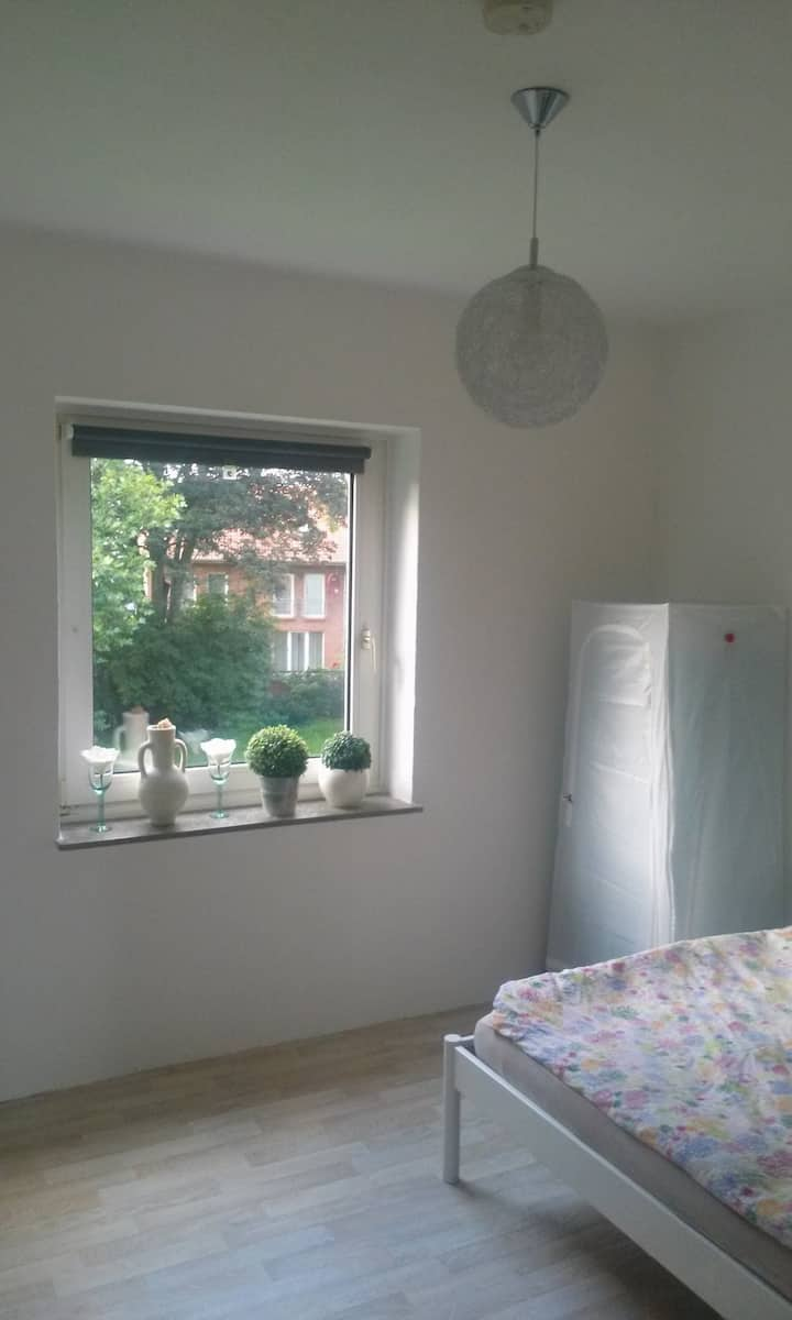 Bright room close to train station and city center