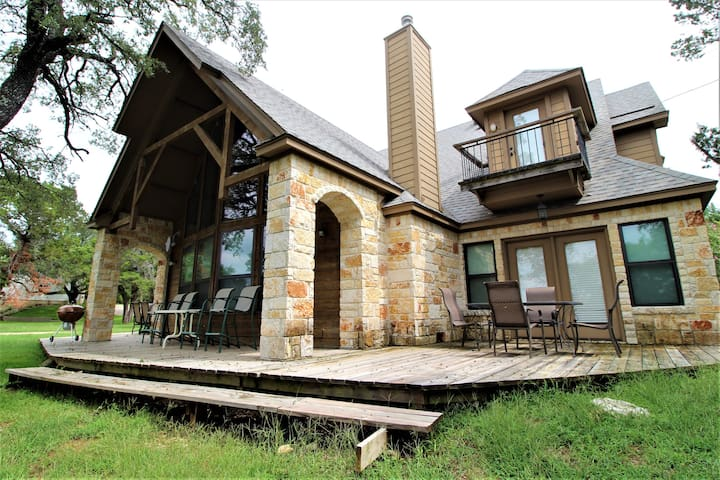 The side and back decks overlook Lake Whitney and have outdoor seating and a charcoal grill for guest use.  Be sure to bring your own charcoal and lighter fluid if you plan to use the grill