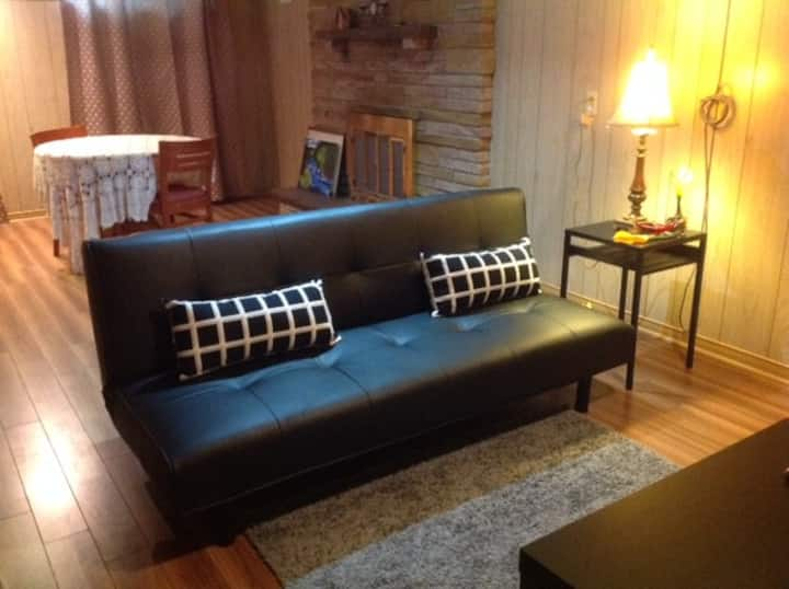 FURNISHED BASEMENT APARTMENT IN A RAISED BUNGALOW