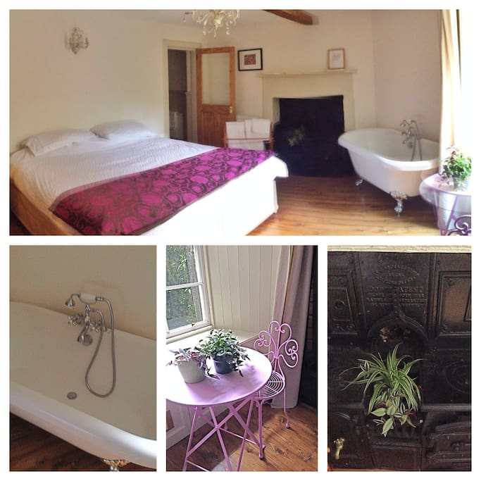 Super king bed, original stove and free-standing bath. Door to the en suite shower room in the background