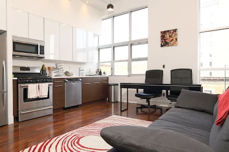 Huge private bedroom with a comfortable queen-sized pillowtop bed, closet, full length mirror, big desk and chair. The room is in a shared modern apartment right on Bedford Ave in Williamsburg, just 15 minutes by subway to Manhattan.