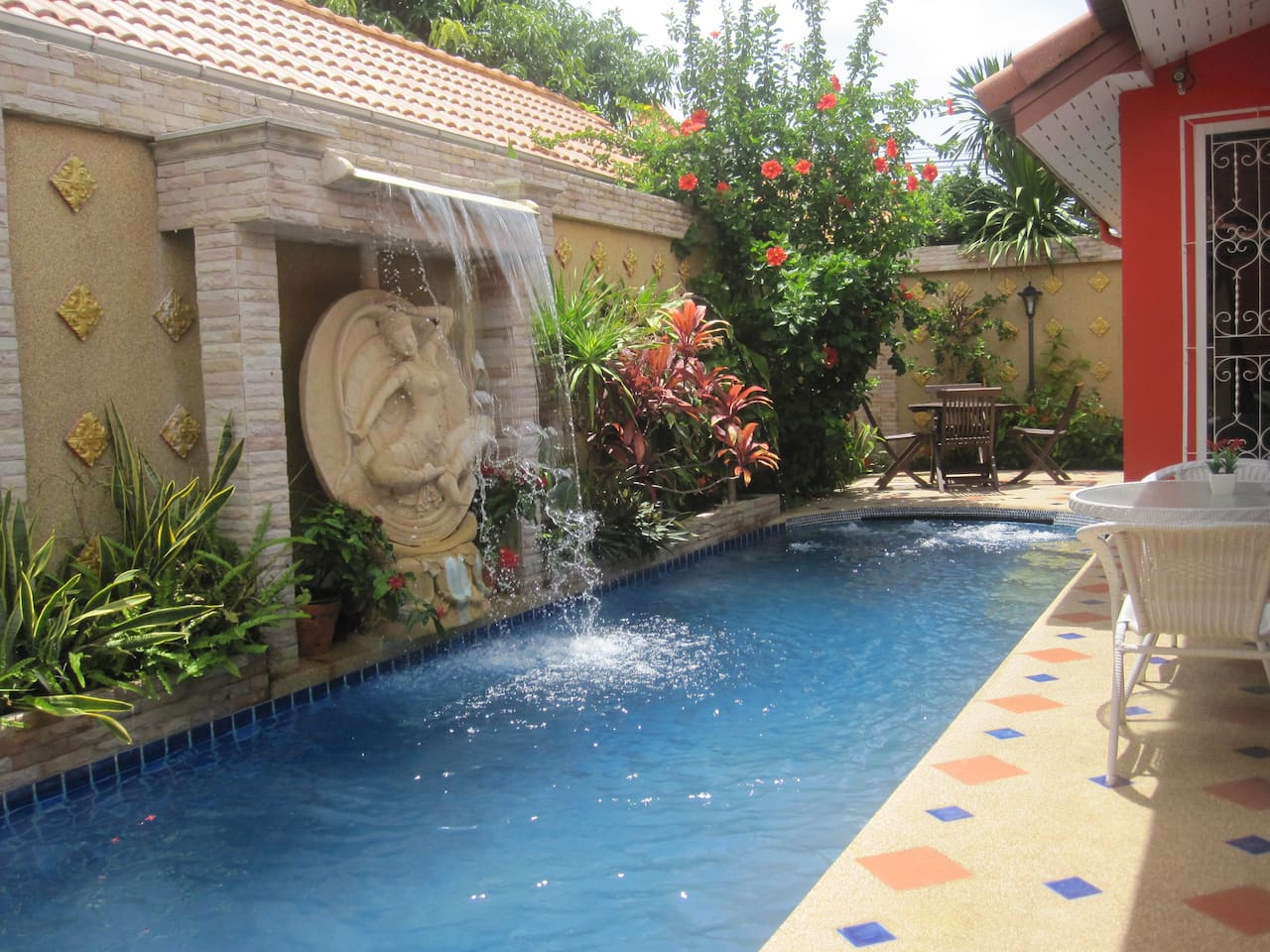 Pool area. Waterfall feature.