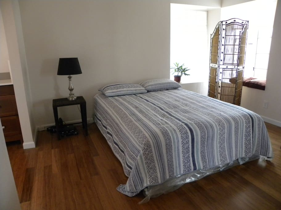 Bright upstairs guest room-has own vanity with sink and has hardwood bamboo flooring