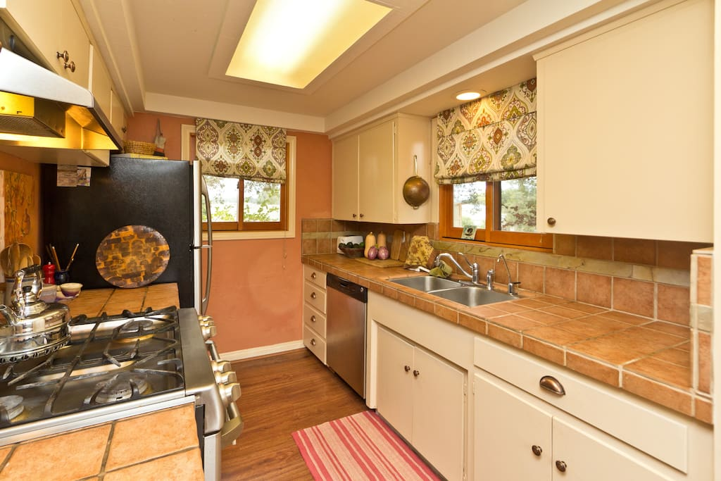 gourmet kitchen with views of the mountains and oaks- himmung birds at the windows