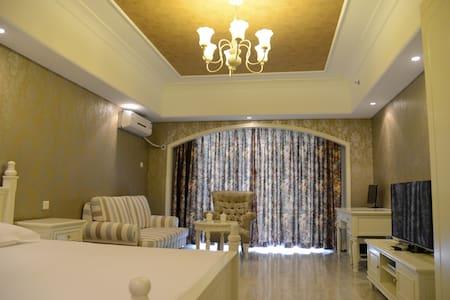 北戴河新区黄金海岸高尔夫球场沙雕大世界附近园景公寓232 - Qinhuangdao