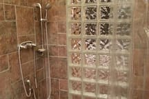Two-thirds person shower with multiple shower heads.