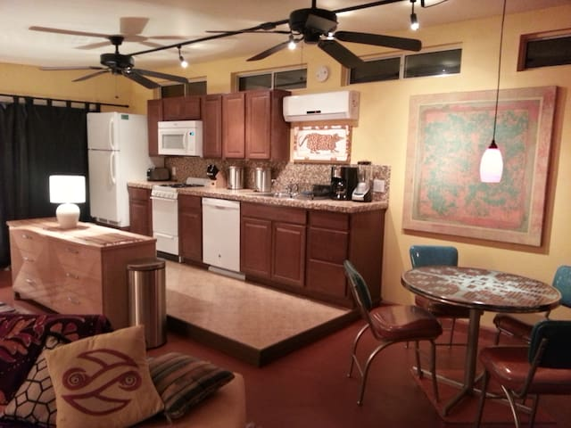 Full kitchen and dining for four.
