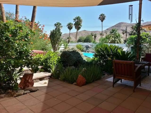 Lush patio with waterfall, fishpond, hot-tub and large unheated pool. Nearby views of Big Horn Sheep wildlife refuge with local hiking trails 5 minutes walk from home.