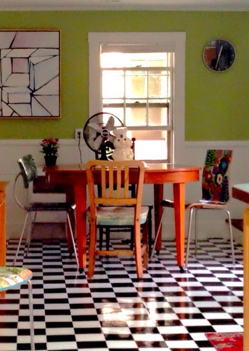 Kitchen with handpainted chairs and stools.