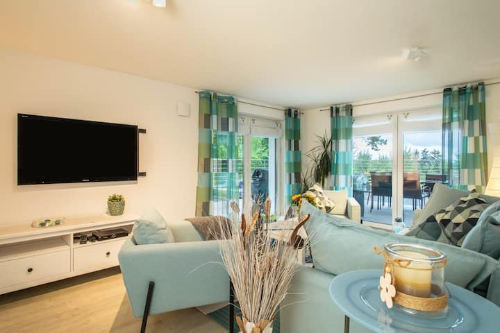 Modern holiday apartment at the Guggenbühl in a quiet location with air conditioning, terrace and garden access; parking available