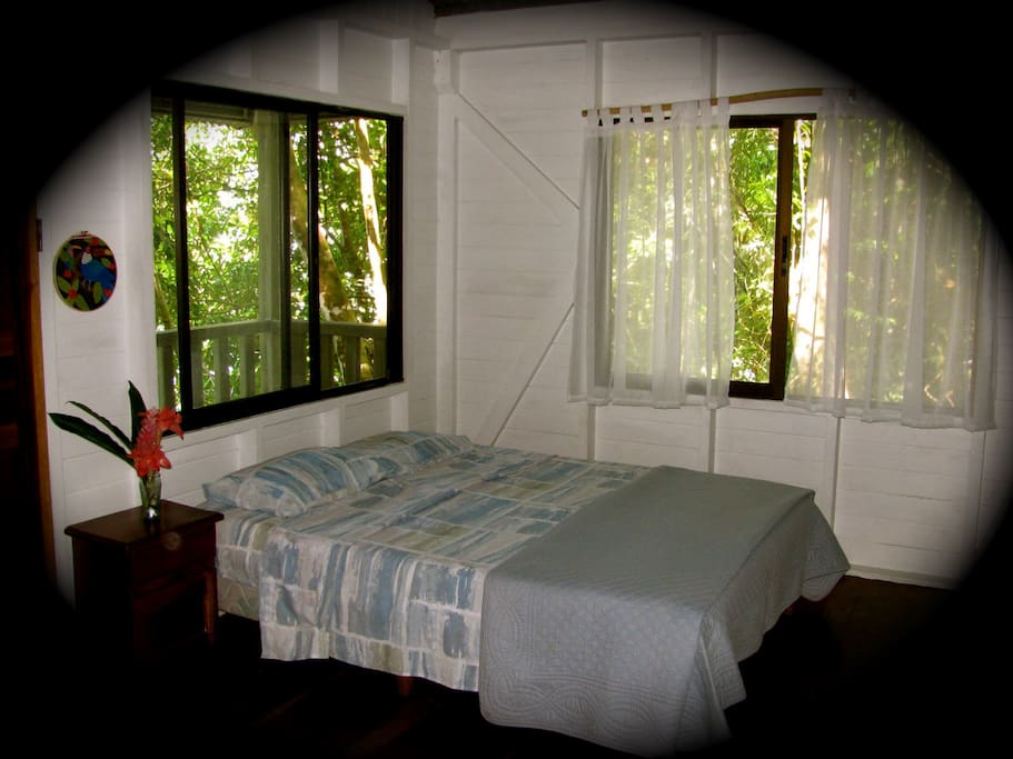 The cabin has one double bed and a set of single bunk beds, with a full bathroom. All window are screened for your comfort. Lighting is provided by solar lanterns