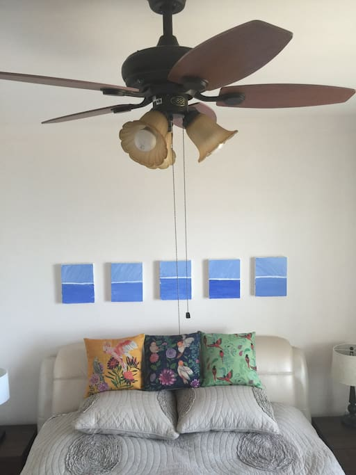 Master bedroom with queen sized bed, ceiling fan n Toshiba A/C.