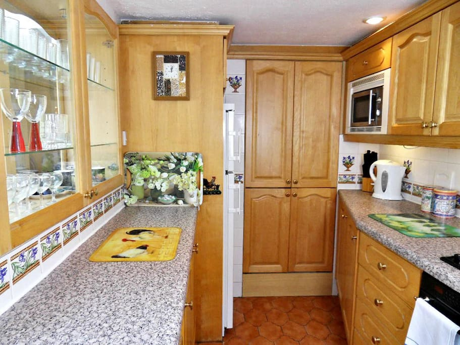 The kitchen is fully equipped with dishwasher, washing machine, tumble drier, fridge freezer etc