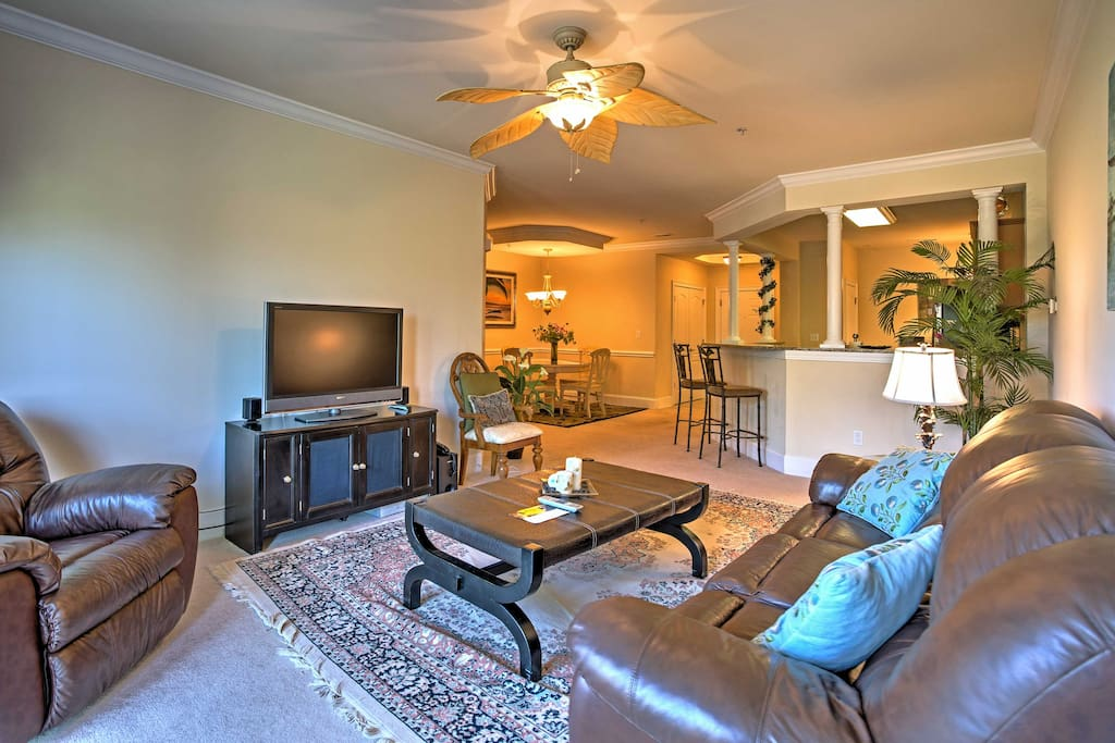 Enjoy the leather furnishings in the living room.