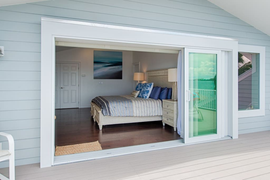 Upper floor master bedroom viewed from the 25' x 14' deck which has fabulous views over the river