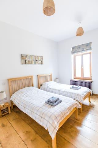 Bedroom 3. Two single beds. En-suite bathroom.