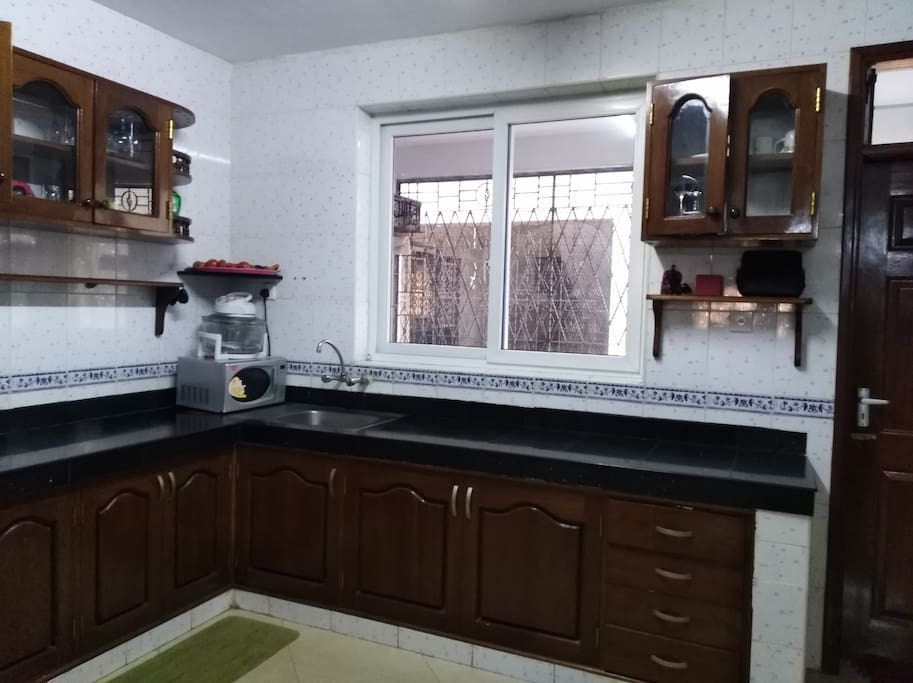 Common very spacious kitchen with dining place, also shared with family