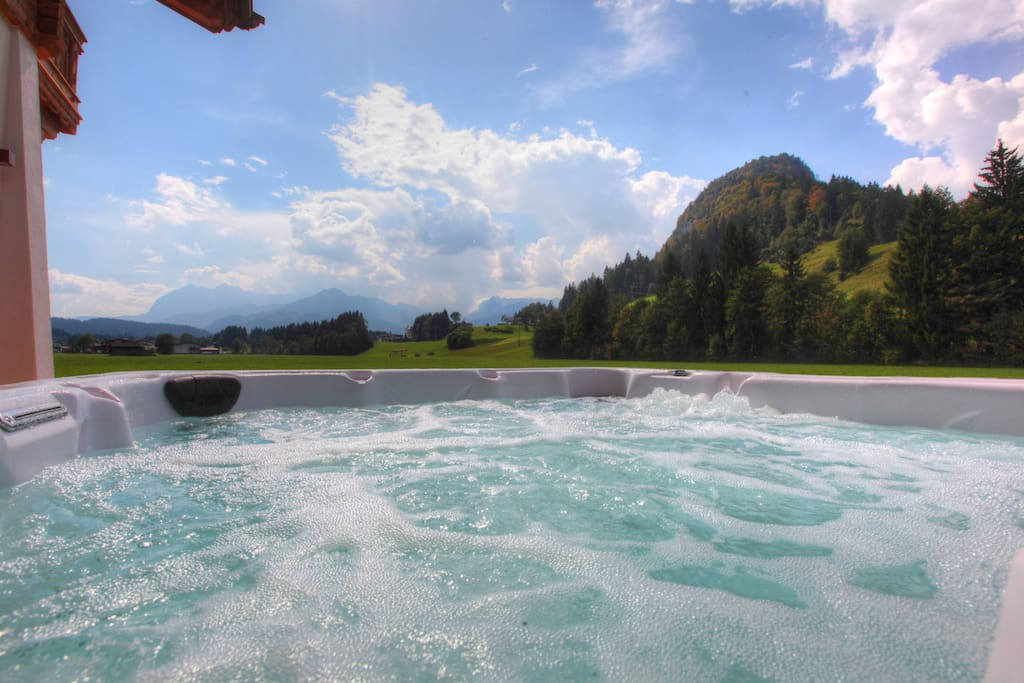 Relax in our jacuzzi surrounded by Alpine mountains and enjoy the view