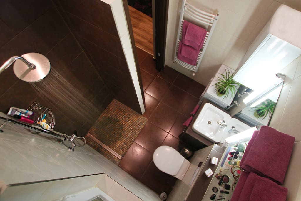 My favorite part of the flat is the bathroom. Special light for the ladies to do their makeup.